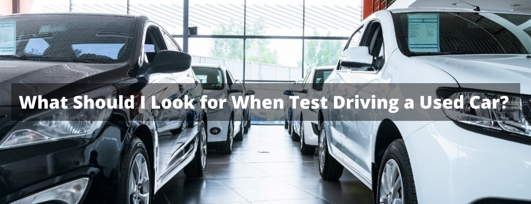 """Closeup of vehicles with """"What Should I Look for When Test Driving a Used Car?"""" white overlay text"""