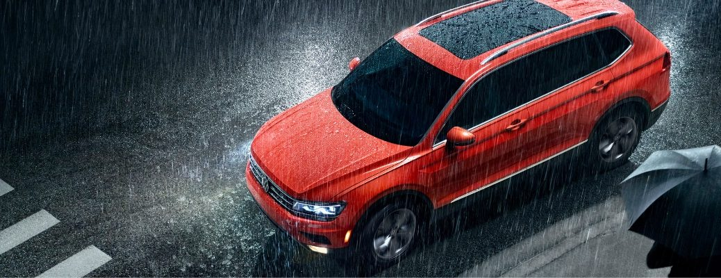 Overhead view of red 2019 Volkswagen Tiguan in rain