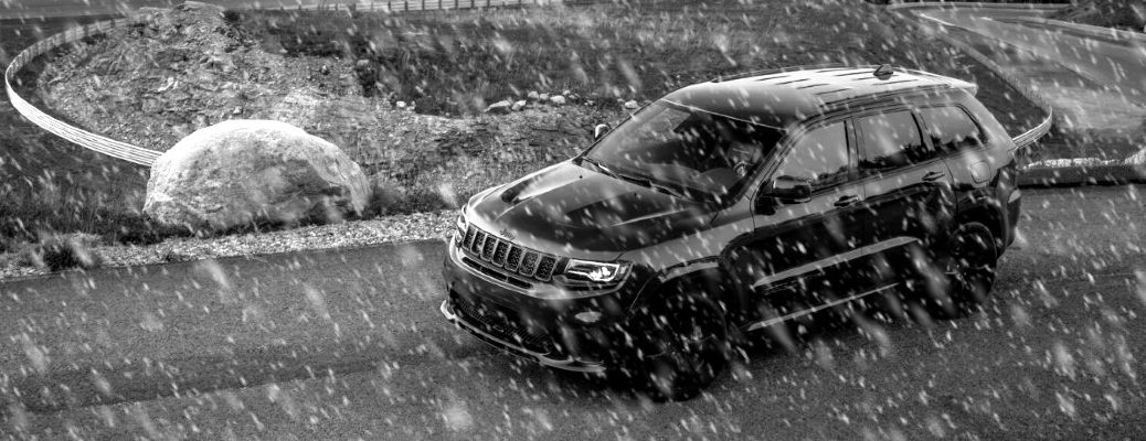 2020 Jeep Grand Cherokee driving in the snow