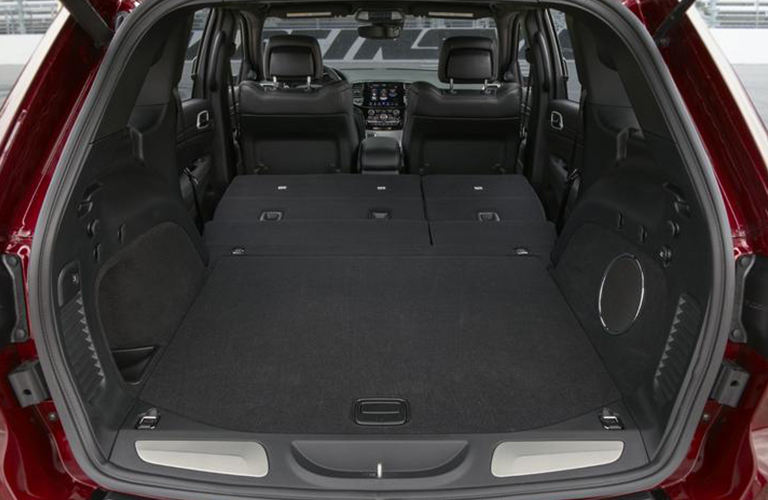 Cargo area of the 2020 Jeep Grand Cherokee with collapsed seats