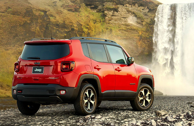 Red 2020 Jeep Renegad at a waterfall