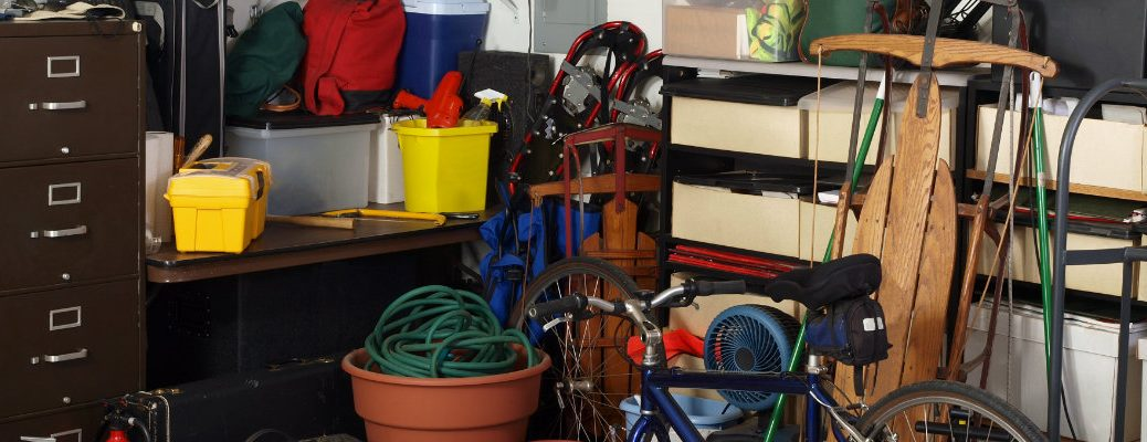 Home garage with tons of clutter
