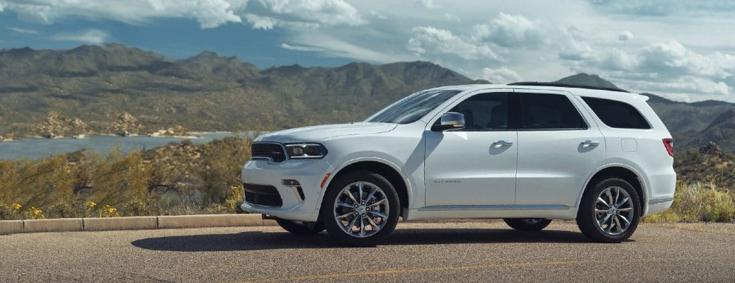 The side view of a white 2021 Dodge Durango.