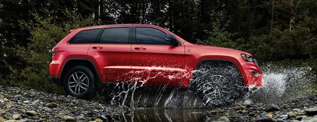 2021 Jeep Grand Cherokee red side view off-road_o