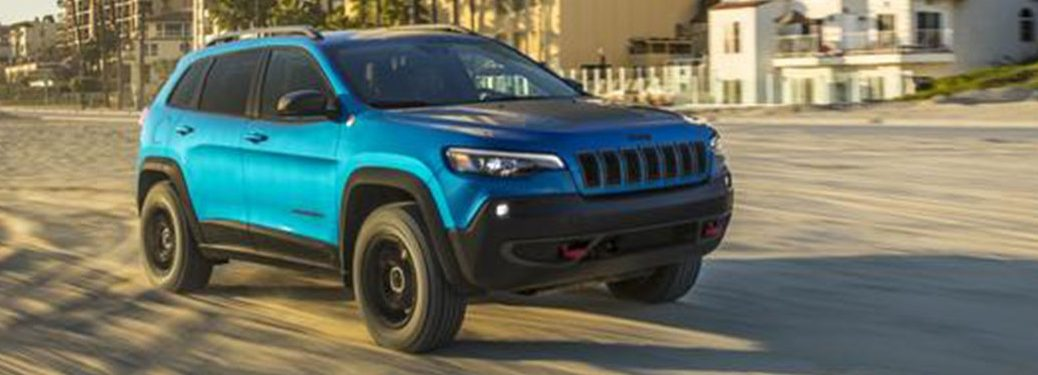 2020 Jeep Cherokee cruising down a dirt road