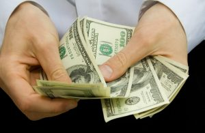 Money in a persons hands