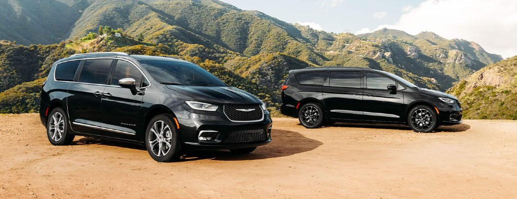 Two 2021 Chrysler Pacifica minivans parked next to each other
