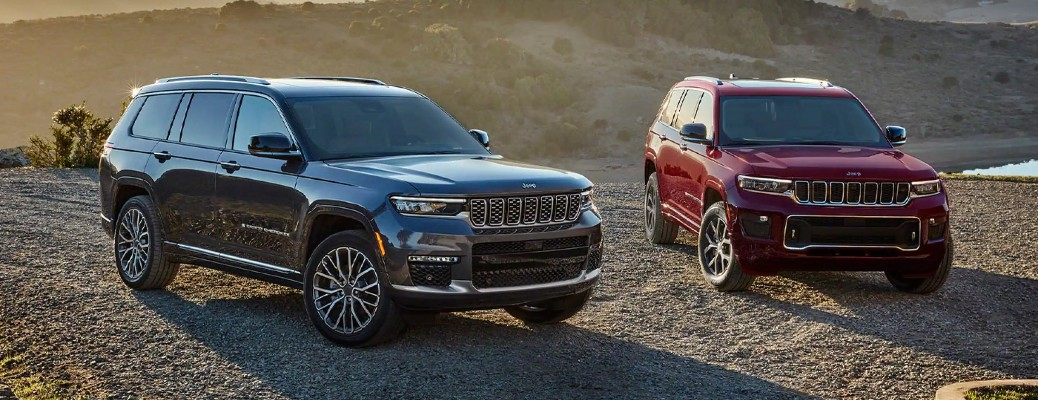 Two 2021 Jeep Grand Cherokee L vehicles parked next to each other
