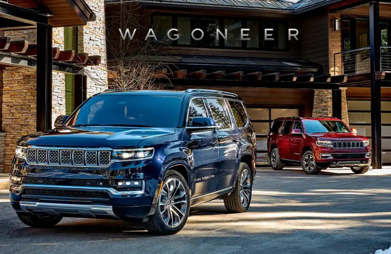 Two 2022 Jeep Grand Wagoneer vehicles with Wagoneer across the top of the photo
