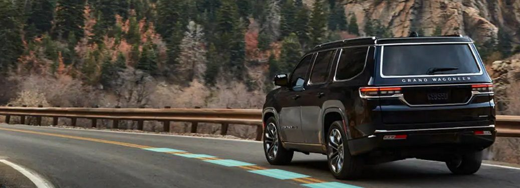 2021 Jeep Grand Wagoneer driving down a mountain road