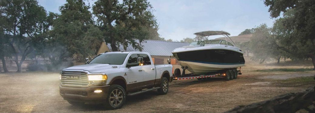 2020 Ram 2500 white exterior front fascia drive side towing a boat