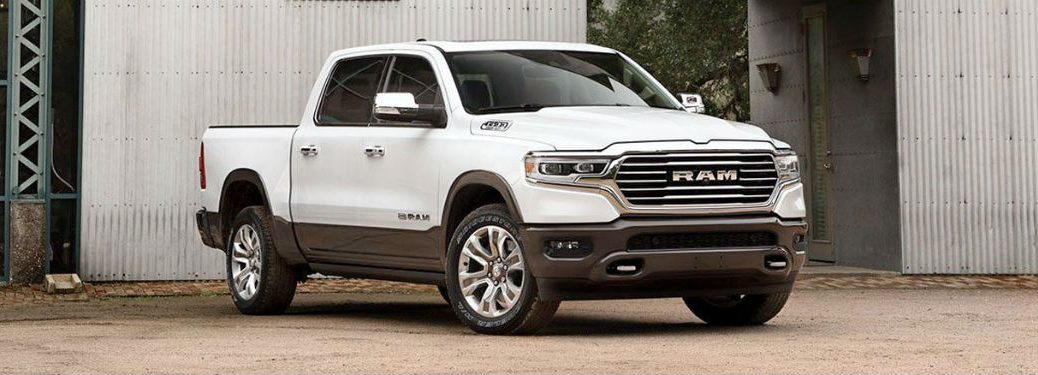 2020 Ram 1500 white exterior front fascia passenger side parked in front of metal building