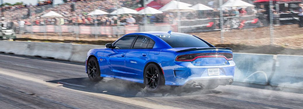 2020 Dodge Charger blue exterior driver side rear fascia driving on racetrack