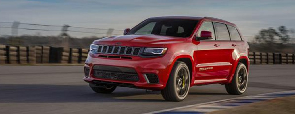 2020 Jeep Grand Cherokee red exterior front driver side on track