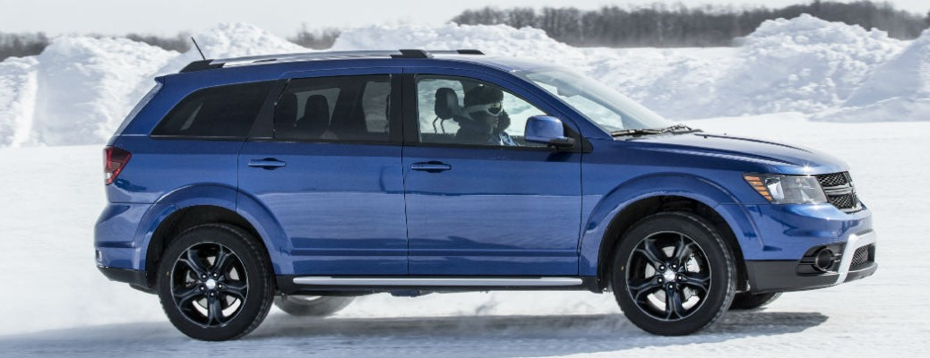 2020 Dodge Journey blue exterior passenger side parked on snow covered ground