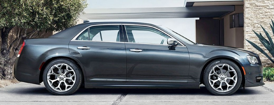 2020 Chrysler 300 grey exterior passenger side parked in front of house