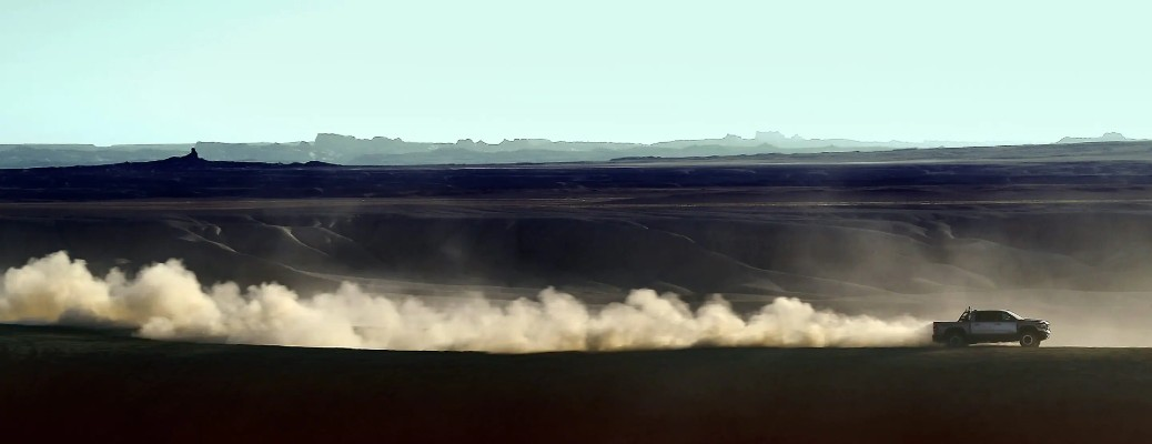 2021 Ram TRX exterior driving in dunes with dust cloud behind