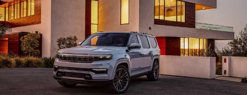 2021 Jeep Grand Wagoneer concept front fascia parked in front of large house