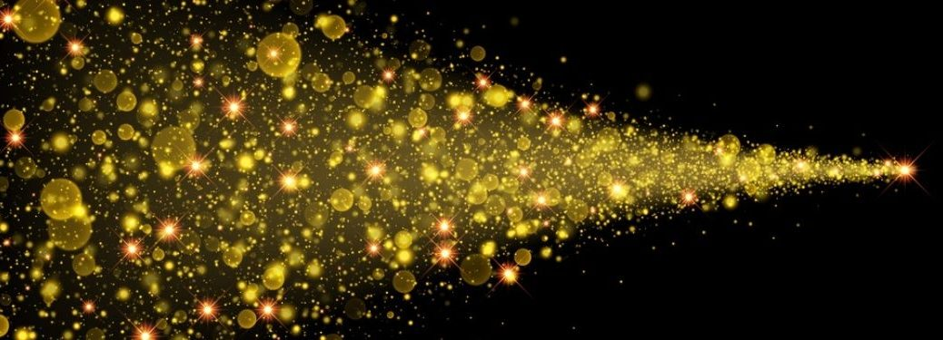 Sparkles starting at narrow point and then fanning outwards against black background
