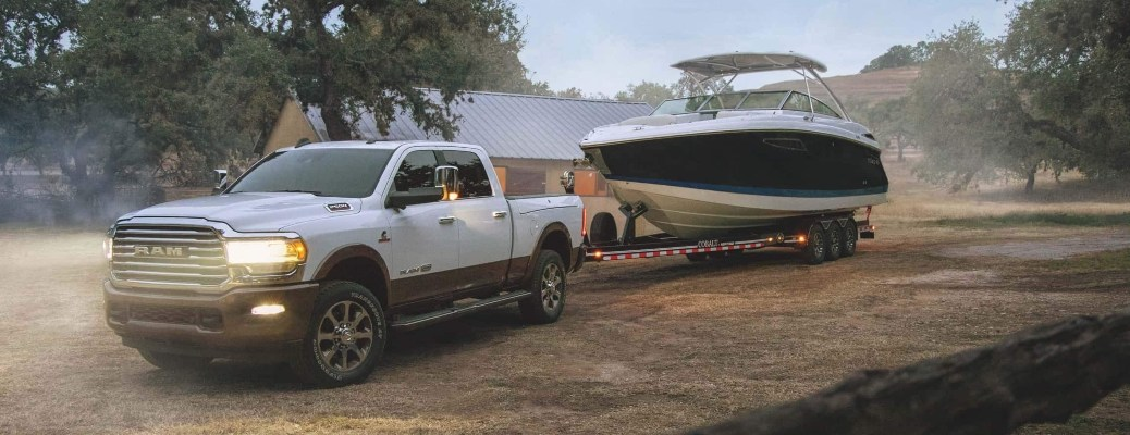 2021 RAM 2500 pulling a boat on dirt road