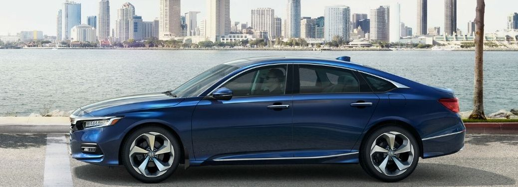 Blue 2020 Honda Accord Next to Water with City in the Background