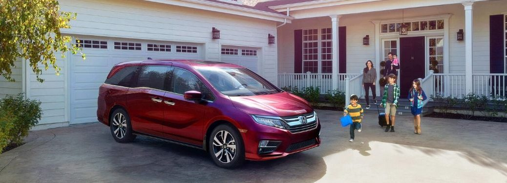 Red 2020 Honda Odyssey and Family in a Driveway