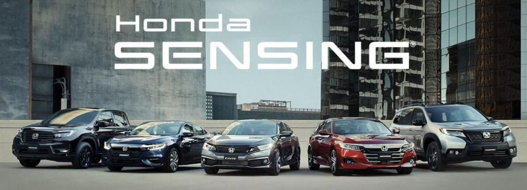 Five Different Honda cars parked in front of buildings with Honda Sensing lettering on top