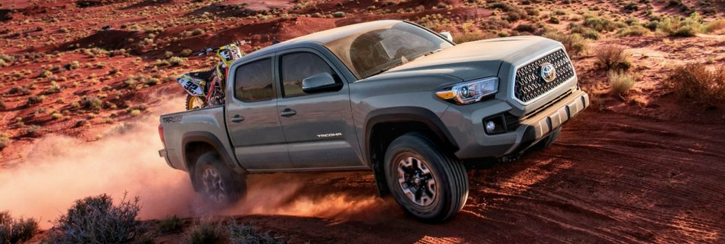 2018 Toyota Tacoma driving on dirt.