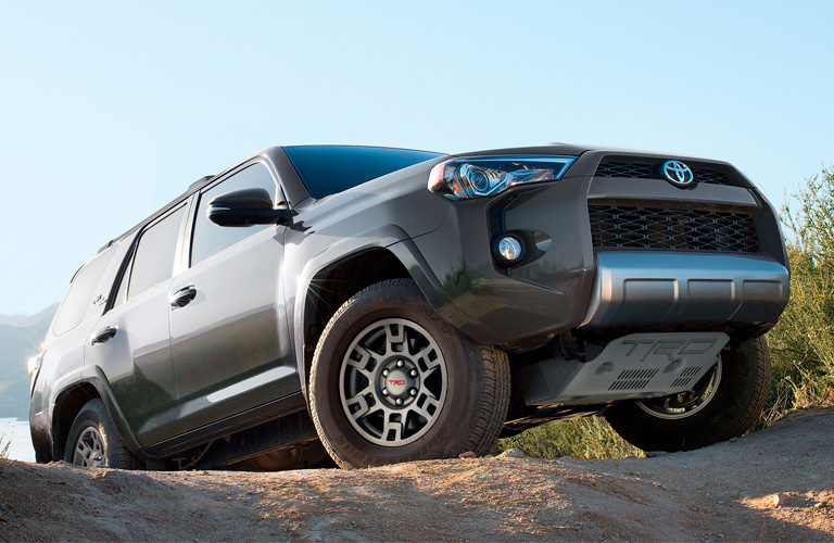 Exterior view of a gray 2019 Toyota 4Runner parked at the top of a dirt hill