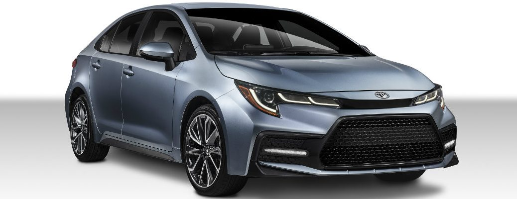 2020 Toyota Corolla exterior shot redesign with silver gray paint color parked in a blank white showroom