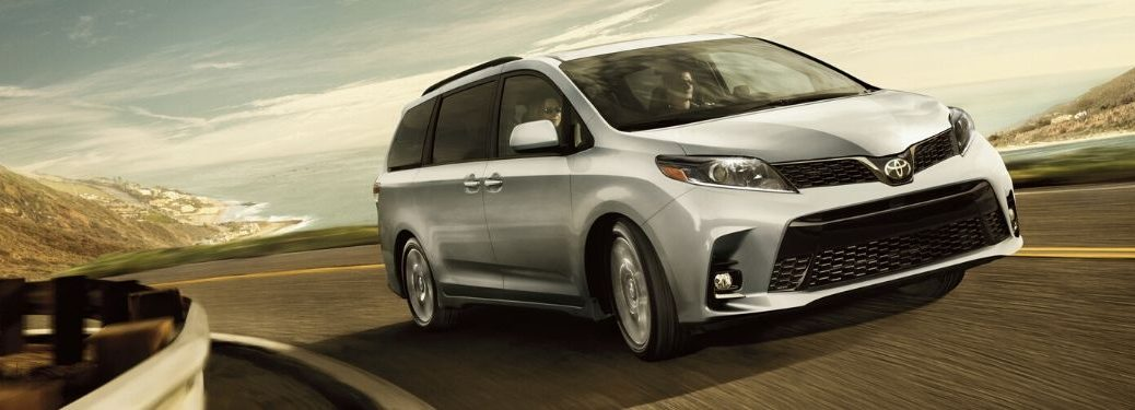 2020 Toyota Sienna driving down road from exterior front passenger side angle