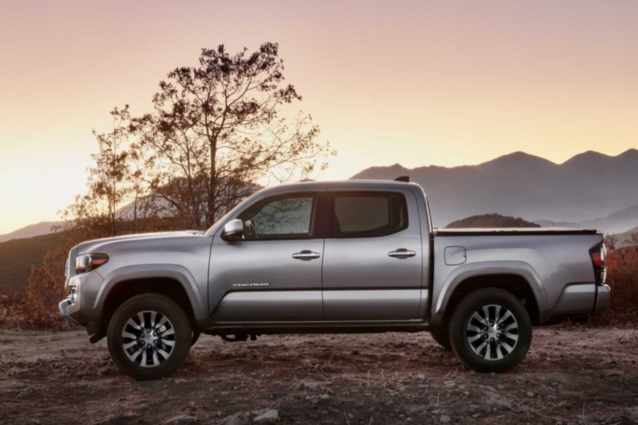 Gray 2020 Toyota Tacoma Limited from passenger view with mountain range in background