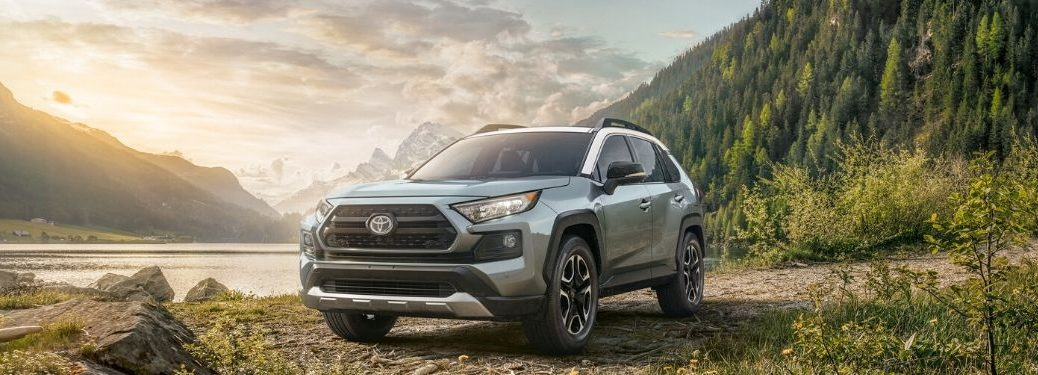2020 Toyota RAV4 Adventure parked in front of water and mountains