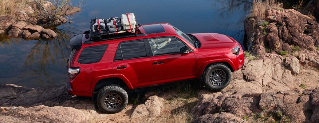2020 Toyota 4Runner driving on rock by water