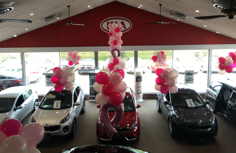 Bridgewater Kia decorated with ribbon and pink balloons