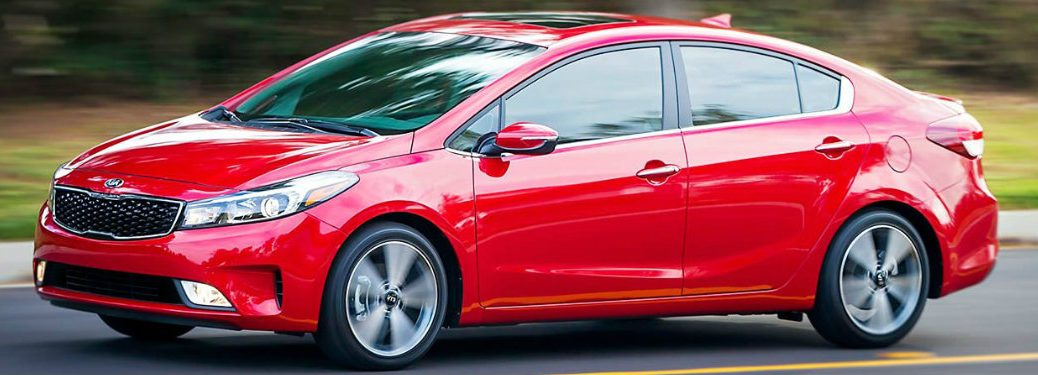 side-profile-of-red-2018-Kia-Forte-driving