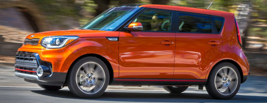 Side profile of orange Kia Soul