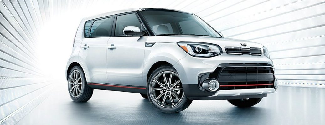 Silver-colored 2019 Kia Soul in a back-lit studio