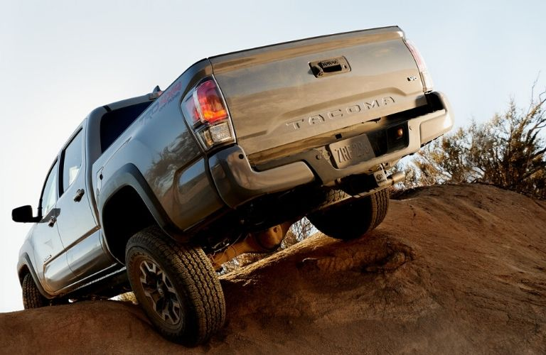 Exterior view of the rear of a tan 2020 Toyota Tacoma