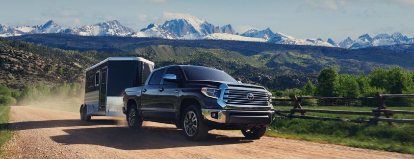 Exterior view of a black 2020 Toyota Tundra towing a trailer
