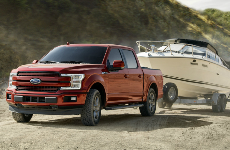 Red 2020 Ford F-150 towing a boat
