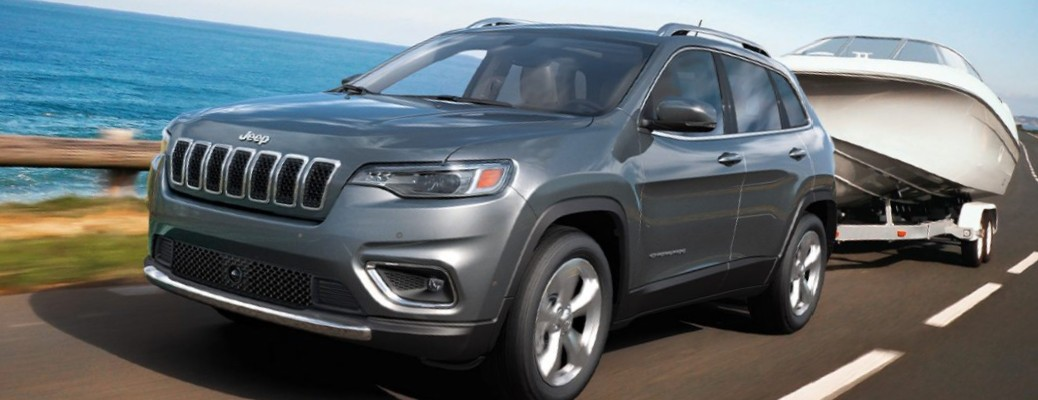 2021 Jeep Cherokee towing a boat