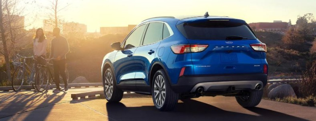 A blue-colored 2021 Ford Escape parked outside