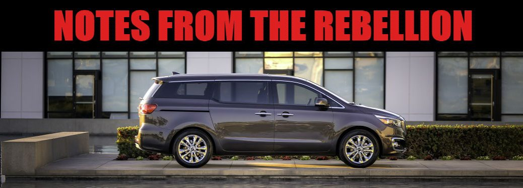 2018 Kia Sedona profile shown in gray blue color parked next to swimming pool in Clearwater FL