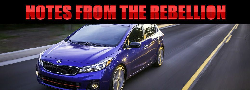 notes from the rebellion header image with kia forte5 in blue driving on highway at fast speed