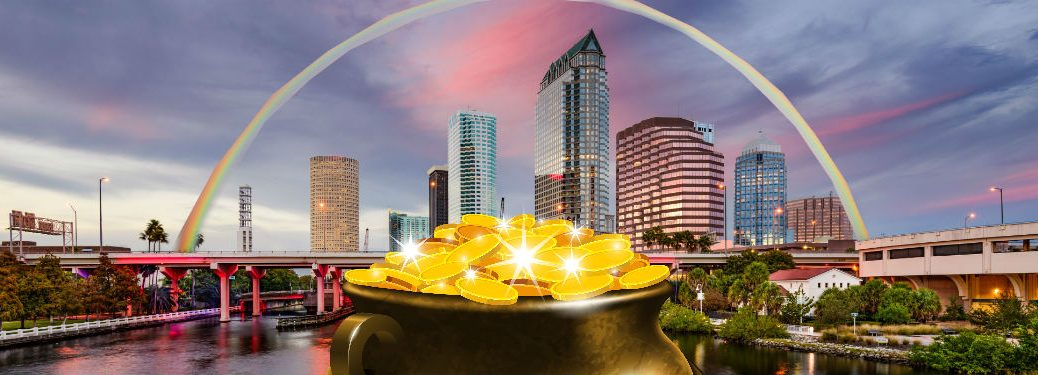 rainbow over tampa skyline with poorly-photoshopped pot of gold in the foreground