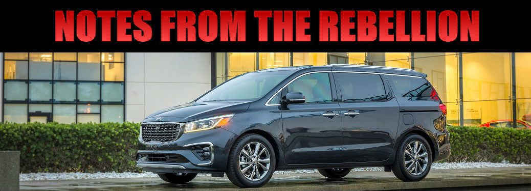 notes from the rebellion text in a box over the 2019 kia sedona parked outside a mansion
