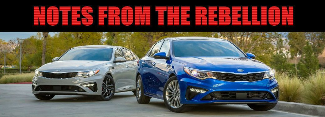 two 2019 kia optimas next to one another with Notes from the Rebellion text overlaid