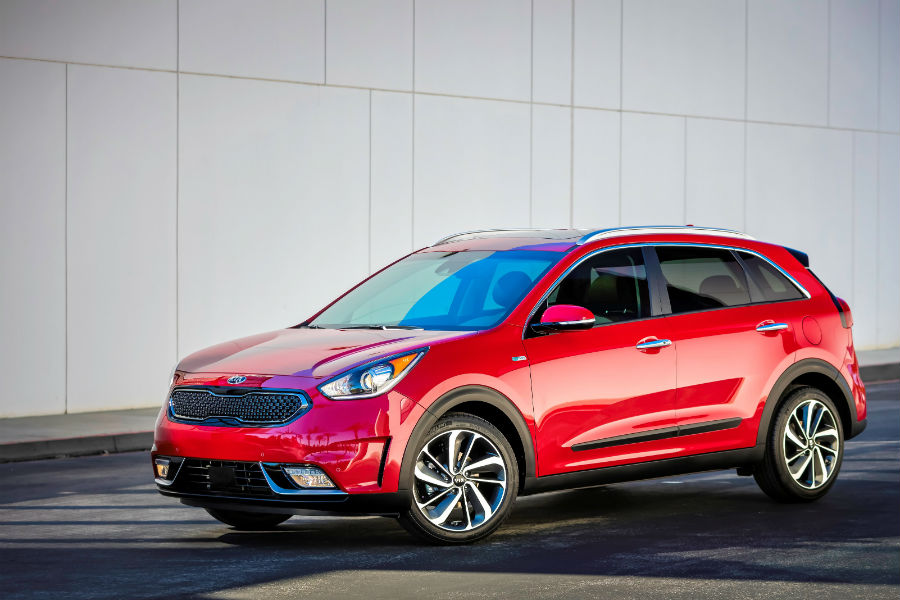 2018 kia niro in red against white wall