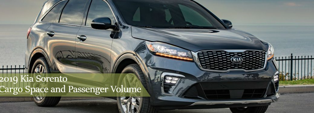 2019 kia sorento parked on hill with text overlay 2019 kia sorento cargo space and passenger volume